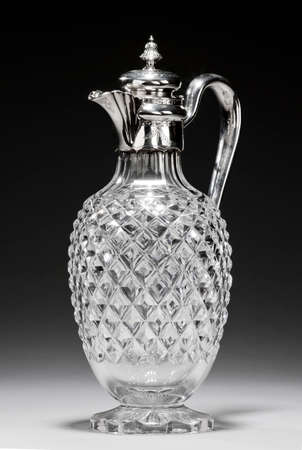 Antique glass decanter or carafe with ornate silver lid