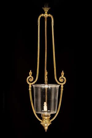 Vintage shaped brass hanging light pendant isolated on black background 免版税图像 - 131364148