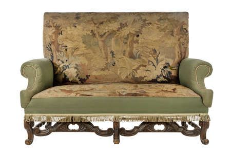 Green antique upholstered sofa couch with old original tapestry on early wooden carved frame isolated on white