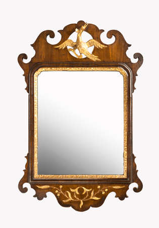 Old antique stylish carved and guilded wall mirror isolated on white