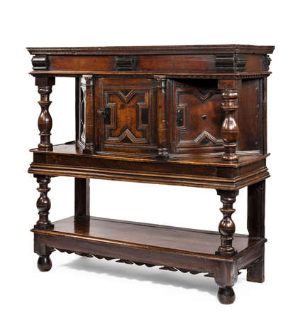 antique early oak Court Cupboard with detailed carving for hallways dining rooms 免版税图像 - 137423789