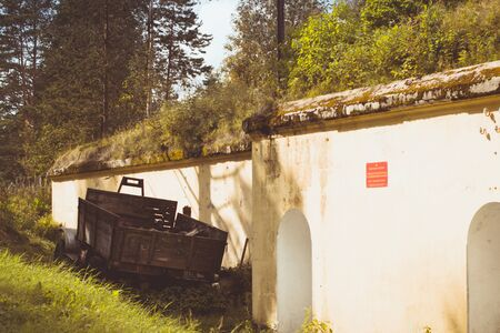 outpost: Rusty car ZIL about Abandoned protective bunker on the military-historical site of Fort Krasnaya Gorka