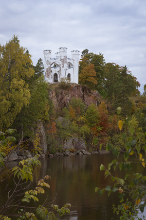 vyborg: VYBORG, RUSSIA - OCTOBER 4, 2015: Isle of the Dead and the chapel of Ludwigstein in Monrepos Mon Repos landscape park at Vyborg, Russia