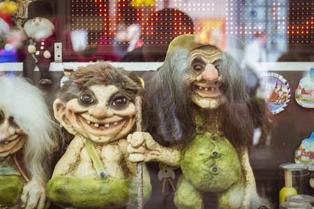 TALLINN, ESTONIA - YUNI 14, 2015: Toy trolls and witches in a shop window on one of the Central streets, Tallinn, Estonia