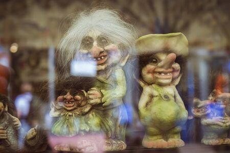 troll dolls: TALLINN, ESTONIA - YUNI 14, 2015: Toy trolls and witches in a shop window on one of the Central streets, Tallinn, Estonia
