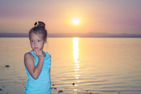 pink sunset: Pensive girl against a pink sunset over salt lake Torrevieja, Valencia, Spain