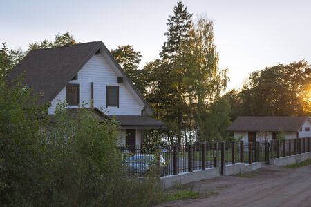 vyborg: VYBORG, RUSSIA - OCTOBER 3, 2015: Luxury homes and cottages in the prestigious cottage village, the evening sunset in October, villas Kirov, Vyborg, Russia