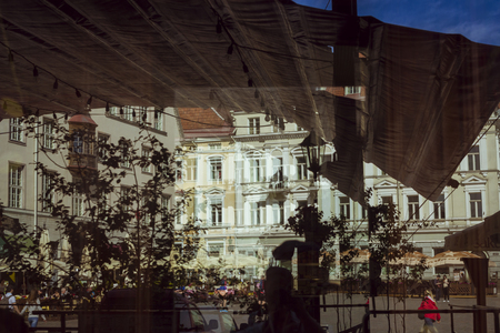 otherworldly: Reflect the Central square of Tallinn in glass showcases, Estonia Stock Photo