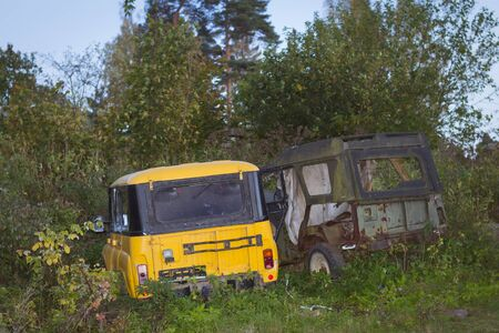 thickets: VYBORG, RUSSIA - OCTOBER 3, 2015: Old broken off-road cars UAZ are in green thickets, villas Kirov, Vyborg, Russia