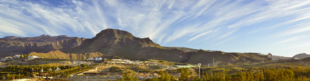 january sunrise: TENERIFE, SPAIN - JANUARY 12, 2013: Sunrise over Teide: a panoramic view of the non-touristic part of the city and El Teide National Park, Tenerife, Canary Islands, Spain