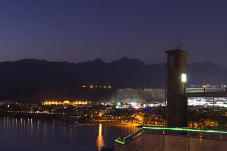 naama bay: SHARM EL SHEIKH, EGYPT - FEBRUARY 19, 2014: February night in Sharm-El-Sheikh, the red sea coast from the height of the hotel beach Albatros resort, Sharm El Sheikh, Egypt Editorial