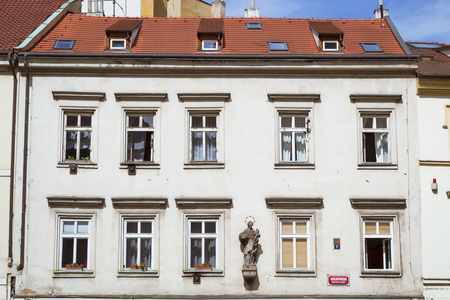 arhitecture: PRAGUE, CZECH REPUBLIC - AUGUST 27, 2015: Decorative moldings on the walls in the streets of old Prague, Czech Republic Editorial
