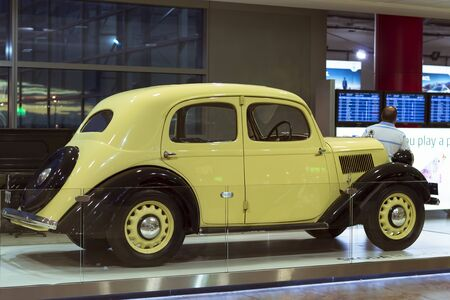 refurbished: PRAGUE, CZECH REPUBLIC - AUGUST 28, 2015: Old refurbished retro car Skoda light yellow color is in the lounge at Prague airport, Czech Republic Editorial