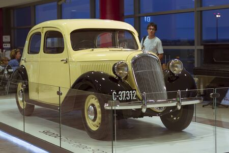 chrom: PRAGUE, CZECH REPUBLIC - AUGUST 28, 2015: Old refurbished retro car Skoda light yellow color is in the lounge at Prague airport, Czech Republic Editorial