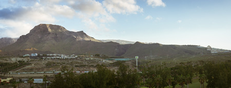 january sunrise: TENERIFE, SPAIN - JANUARY 14, 2013: Sunrise over Teide: a panoramic view of the non-touristic part of the city and El Teide National Park, Tenerife, Canary Islands, Spain