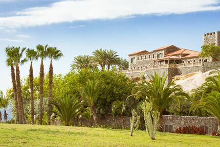 adeje: TENERIFE, SPAIN - JANUARY 14, 2013: Plaza Playa del Duque, view of the Duke Castle El Duque Castle, Costa Adeje, Tenerife, Canary Islands, Spain