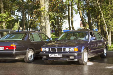 automaker: SAINT-PETERSBURG, RUSSIA - AUGUST 3, 2013: Old-car BMW 7-series at the meeting, fans of the Bavarian automaker, Krestovsky island, St. Petersburg Editorial