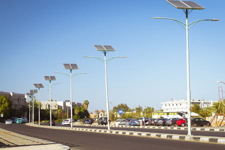 SHARM EL SHEIKH, EGYPT - FEBRUARY 20, 2014: Solar panels on electric pole for lighting on the road in the city, use of solar energy, Sharm El Sheikh, Egypt Editorial