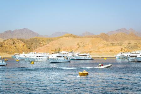 sharm el sheikh: SHARM EL SHEIKH, EGYPT - FEBRUARY 25, 2014: Marina: Pleasure sightseeing boats on the Parking lot of boat Park, boat trip for tourists, Sharm El Sheikh, Egypt