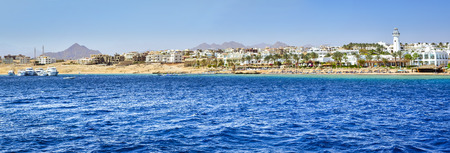 el sheikh: SHARM EL SHEIKH, EGYPT - FEBRUARY 25, 2014: Tourist boat trip around the Sinai on the white yacht, a luxury vacation for tourists in the Red sea, relax on the waves, Sharm El Sheikh, Egypt