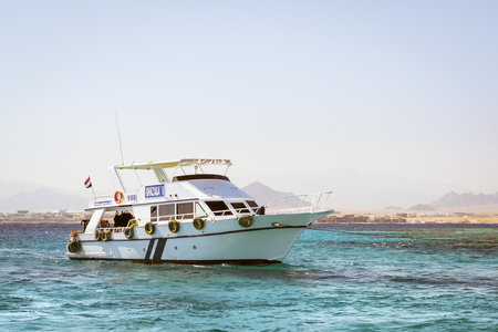 sinai: SHARM EL SHEIKH, EGYPT - FEBRUARY 25, 2014: Tourist boat trip around the Sinai on the white yacht, a luxury vacation for tourists in the Red sea, relax on the waves, Sharm El Sheikh, Egypt
