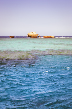 sharm: SHARM EL SHEIKH, EGYPT - FEBRUARY 25, 2014: The sunken shipwreck on the reef, Red Sea, Sharm El Sheikh, Egypt