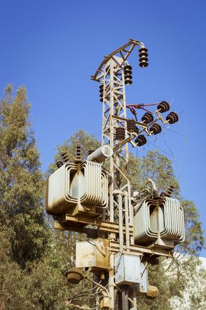 el sheikh: SHARM EL SHEIKH, EGYPT - FEBRUARY 27, 2014: Electrical poles of high voltage in blue sky, Sharm El Sheikh, Egypt