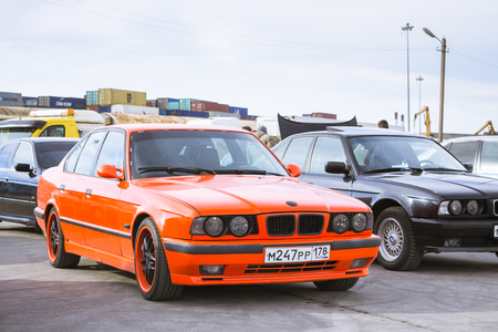 automaker: SAINT-PETERSBURG, RUSSIA - APRIL 5, 2014: Old-car BMW 5-series e34 at the meeting fans of the Bavarian automaker, St. Petersburg, Russia