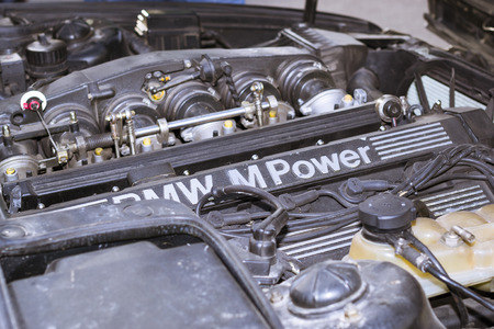 automaker: SAINT-PETERSBURG, RUSSIA - APRIL 5, 2014: Engine compartment: motor m-power with attachments, old-car BMW, Bavarian automaker, St. Petersburg, Russia
