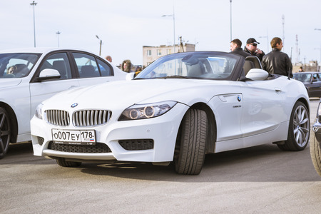 automaker: SAINT-PETERSBURG, RUSSIA - APRIL 5, 2014: White coupe BMW-car z4 at the meeting fans of the Bavarian automaker, St. Petersburg, Russia