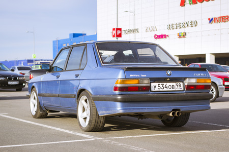 automaker: SAINT-PETERSBURG, RUSSIA - APRIL 5, 2014: Blue old-car BMW 5-series at the meeting fans of the Bavarian automaker, St. Petersburg, Russia Editorial