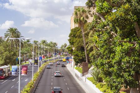 carrer: ALICANTE, SPAIN - SEPTEMBER 9, 2014: view of the major highways Carrer de Jovellanos with modern pedestrian bridge. Alicante, Spain Editorial
