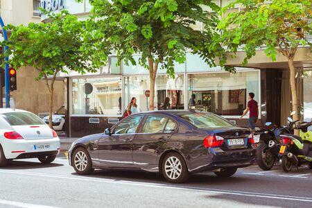 rambla: ALICANTE, SPAIN - SEPTEMBER 9, 2014: Modern car BMW 3 series on popular tourist street Rambla Mendez Nunez, Alicante, Valencia, Spain Editorial