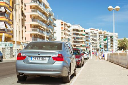 mariano: TORREVIEJA, SPAIN - SEPTEMBER 13, 2014: silver-metallic modern  car BMW 3-series 320d on sunny street, Av Doctor Mariano Ruiz Canovas, Torrevieja, Valencia, Spain