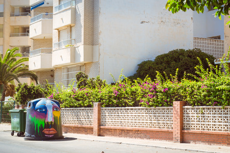 mariano: TORREVIEJA, SPAIN - SEPTEMBER 13, 2014: Art-decorated trashcan on sunny street, Streetart graffiti, Av Doctor Mariano Ruiz Canovas, Torrevieja, Valencia, Spain