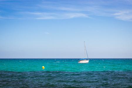 av: Sailboats floating in sea on horizon, coast of Sunny beach, Av de los Marineros, Torrevieja, Valencian Community, Spain