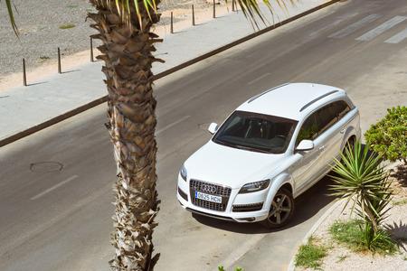 paseo: TORREVIEJA, SPAIN - SEPTEMBER 13, 2014: All-wheel drive German car Audi q7 quattro on sunny street, Paseo Dique de Levante, Torrevieja, Valencia, Spain Editorial