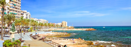 josep: TORREVIEJA, SPAIN - SEPTEMBER 13, 2014: Sculpture called man of sea, author Josep Ricart i Maimir, opened in 1975. Bronze monument sailor on sunny Mediterranean beach, Paseo Juan Aparicio, Torrevieja, Valencia, Spain