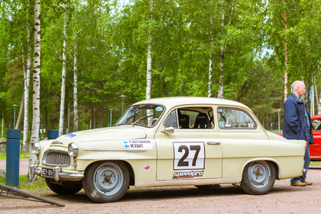 automaker: KOTKA, FINLAND - JUNE 14, 2014: Skoda Felicia coupe sport-car parked on shore of Finnish gulf. Festival and exhibition of retro-club of the Czech automaker. Island Mussalo, Kotka, Southern Finland, Suomi