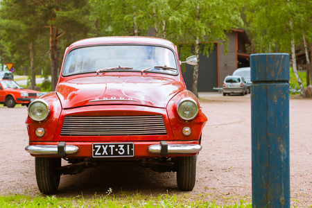automaker: KOTKA, FINLAND - JUNE 14, 2014: Red Skoda Felicia coupe-wagon parked on shore of Finnish gulf. Festival and exhibition of retro-club of the Czech automaker. Island Mussalo, Kotka, Southern Finland, Suomi Editorial
