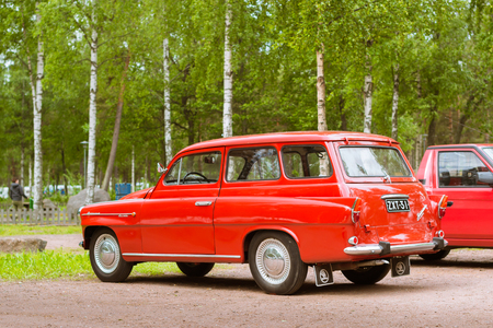 suomi: KOTKA, FINLAND - JUNE 14, 2014: Red Skoda Felicia coupe-wagon parked on shore of Finnish gulf. Festival and exhibition of retro-club of the Czech automaker. Island Mussalo, Kotka, Southern Finland, Suomi Editorial