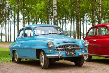 suomi: KOTKA, FINLAND - JUNE 14, 2014: Skoda Felicia coupe cars parked on shore of Finnish gulf. Festival and exhibition of retro-club of the Czech automaker. Island Mussalo, Kotka, Southern Finland, Suomi Editorial