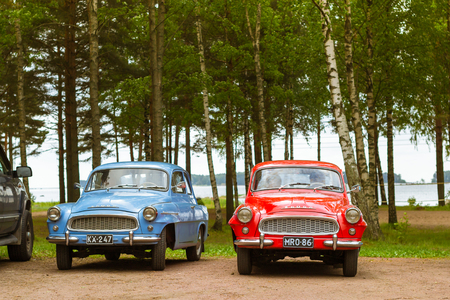 automaker: KOTKA, FINLAND - JUNE 14, 2014: Skoda Felicia coupe cars parked on shore of Finnish gulf. Festival and exhibition of retro-club of the Czech automaker. Island Mussalo, Kotka, Southern Finland, Suomi Editorial