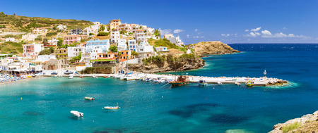 secluded: Harbour with marine vessels, boats and lighthouse. Panoramic view from a cliff on a Bay with a beach and architecture Bali - vacation destination resort, with secluded beaches and clear turquoise ocean waters, Rethymno, Crete, Greece
