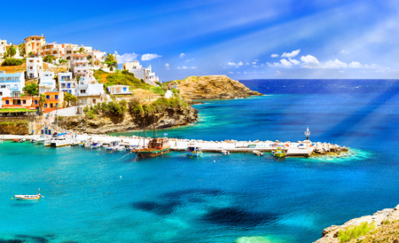 secluded: BALI, GREECE - MAY 4, 2016: Harbour with marine vessels, boats and lighthouse. Panoramic view from a cliff on a Bay with a beach and architecture Bali - vacation destination resort, with secluded beaches and clear turquoise ocean waters, Rethymno, Crete,