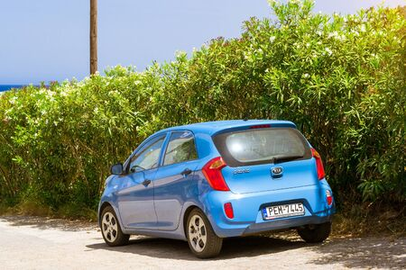auto leasing: BALI, GREECE - APRIL 29, 2016: Rental car Kia Picanto are parked on sloping street, about office leasing auto. Subcompact economical transportation. Resort village Bali, Rethymno, Crete, Greece Editorial