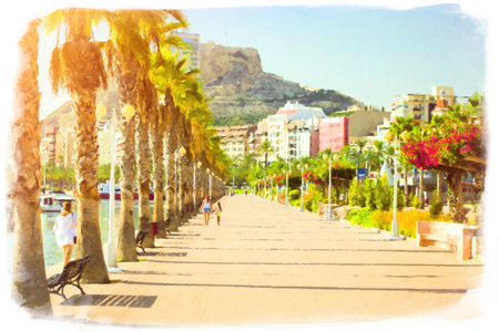 julio: Alicante, Spain. Prospect Av del Almirante Julio Guillen Tato with palm trees, view of castle Santa Barbara, Valencia. Harbour with marine vessels, boats and lighthouse. View from a cliff on a Bay with beach and architecture Crete - vacation destination r Stock Photo