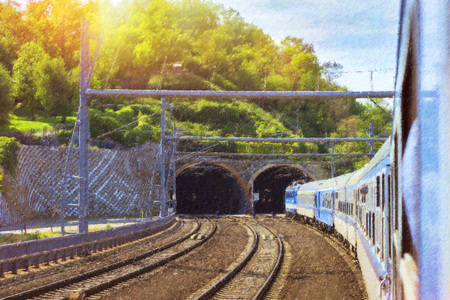 Locomotive enters the tunnel. Passenger train departs from the main train station of Prague to Kutna Hora. Prague, Czech Republic. Photo stylized illustration