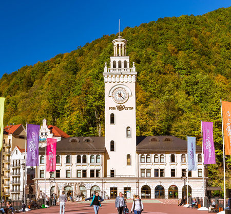 SOCHI, RUSSIA - OCTOBER 31, 2015: Rosa Khutor Clock tower and infrastructure of Alpine ski resort. Constructed from 2003 to 2011. Krasnaya Polyana, Sochi, Krasnodarskiy kray, Russia