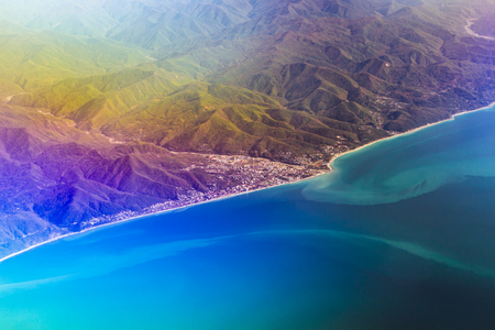 Airplane flying, sky over Black sea and Caucasus mountains. View of sky from aircraft, long distance travel by airtransport. Russian airlines, Krasnodar Krai, Lazarevskaya Stock Photo